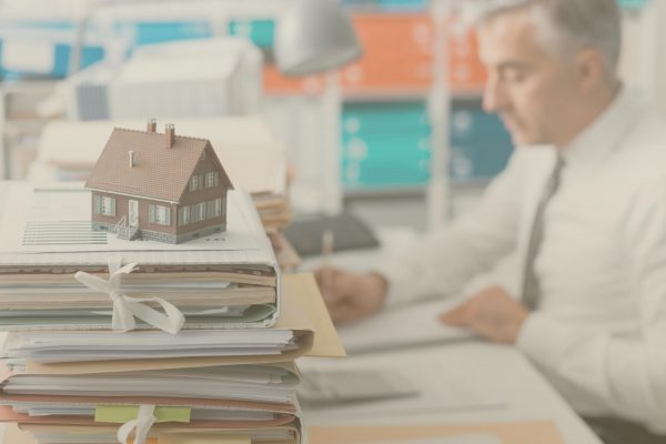 real-estate-mortgage-loans-and-paperwork-PXTTACG-scaled (1)